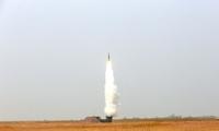 防空旅红蓝实弹对抗演练 麦田中发射导弹