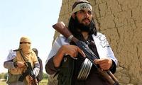 """美国特使与塔利班就阿?#32531;?#25764;军问题达成""""协议草案"""""""